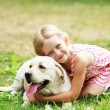 Little girl with her dog — Stock Photo #30054263