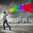 Young man and colour splash — Stock Photo