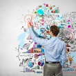 Businessman drawing sketches on wall — Stock Photo #30055907