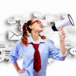 Funny looking woman with megaphone — Stock Photo #30056089