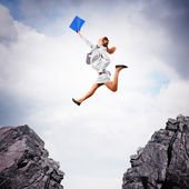 Young businesswoman jumping — Stock Photo