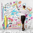 Businesswoman drawing on wall — Stock Photo #30140629