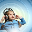 Little girl in headphones — Stock Photo