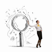 Businesswoman with magnifier — Stock Photo