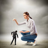 Businesswoman puppeteer — Stock Photo