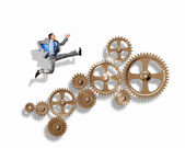 Businessman and mechanism elements — Stock Photo