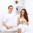 Young happy couple at hone together s — Stock Photo #30240591