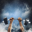 Human hands lifting barbell — Stock Photo
