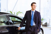 Businessman near car — Stock Photo