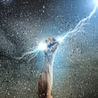 Human hand holding lightning — Stock Photo