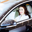 Young woman in car — Stock Photo