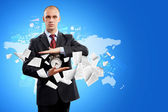 Business man holding alarmclock — Stock Photo