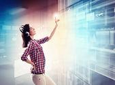 Woman touching virtual screen — Stock Photo