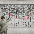 Businessman solving labyrinth problem — Stock Photo #30424099