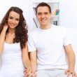 Young happy couple at hone together s — Stock Photo #30424325