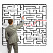 Businessman solving labyrinth problem — Stock Photo #30424661