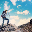 Young tourist atop of mountain — Stock Photo