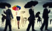 Businesswoman with umbrella — Stock Photo