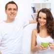 Young happy couple at hone together s — Stock Photo #30620539