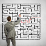 Businessman solving labyrinth problem — Stock Photo