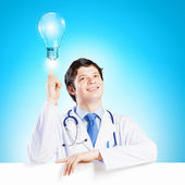 Médecin avec bannière vierge — Photo