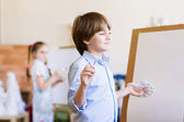 Cute boy painting — Stock Photo