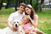 Happy family having fun outdoors — Stockfoto