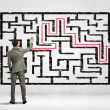 Businessman solving labyrinth problem — Stock Photo #30807595