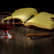 Stock Photo: Cognac, cigar and an old book nearby