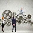 Stock Photo: Business people and mechanism elements