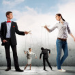 Businesspeople with marionettes — Stock Photo #30808353