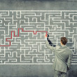 Businessman solving labyrinth problem — Stock Photo #30809373