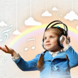 Foto de Stock  : Little girl in headphones