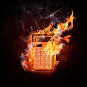 Calculator in fire — Stock Photo