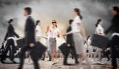 Businesswoman in blindfold among group of people — Stock Photo