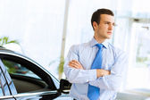 Businessman near car — Stock Photo