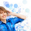Happy smiling young man dancing — Stock Photo #30882103