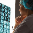 Woman doctor examining x-ray — Stock Photo