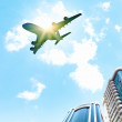 Airplane above city — Stock Photo