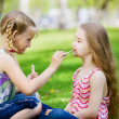 Little girls in park — Stock Photo