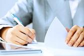 Signing documents — Stockfoto