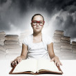 Foto Stock: Girl reading book
