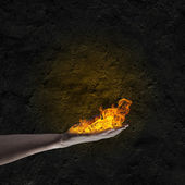 Fire in hand — Stock Photo