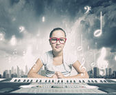 School girl with piano — Foto Stock