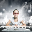 Foto Stock: School girl with piano