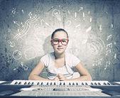 School girl with piano — Stock Photo