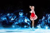 Little girl figure skating — Stock Photo