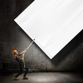 Engineer with banner — Stock Photo