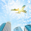 Stock Photo: Airplane above city