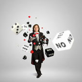 Magician with dice — Stock Photo